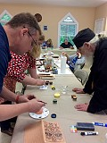 New Students learn to mix pigments.