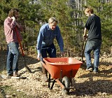 Volunteers clean and do landscaping on clean-up day.